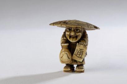 Netsuke en ivoire, vendeur de saké debout...