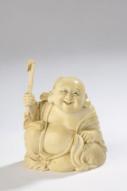 Sujet en ivoire à patine jaune, Hotei assis,...