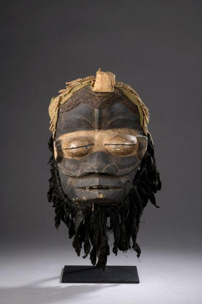 WE MASK, Ivory Coast  Medium-hard wood, pigments,...
