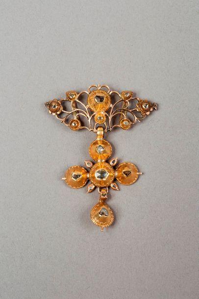 Croix en or jaune 14k 585‰, probablement...