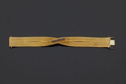 Bracelet souple en or jaune, 18k 750‰, composé...