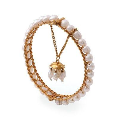 Bracelet en or jaune 18K 750‰, en fils torsadés...