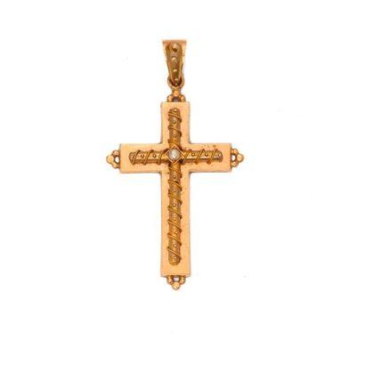 Croix en or jaune 18K 750‰, parée d'un motif...