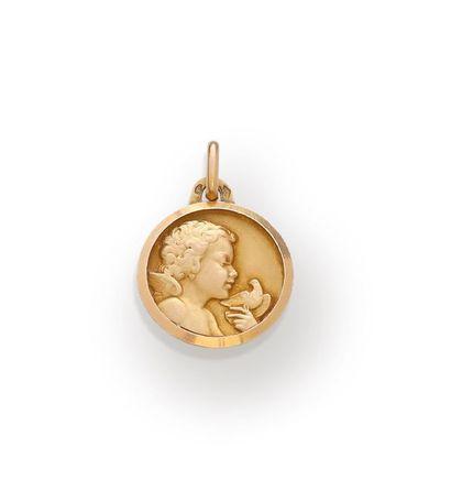Médaille ronde en or jaune 18k 750‰ figurant...