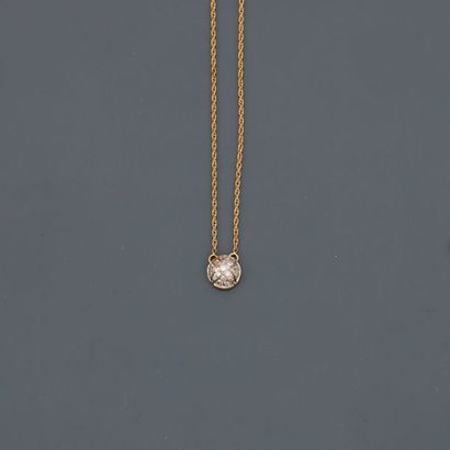 Yellow gold necklace, 750 MM, centred on a curved pattern covered with diamonds,...