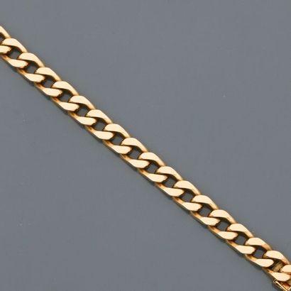 CHAUMET, Elégant bracelet gourmette en or...