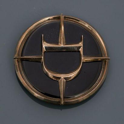 DIOR, Broche - pendentif ronde en métal argenté rhodié, appliquée d'émail noir,...