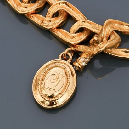 DIOR, Half set of rhodium-plated gold metal ornament, Bracelet applied with off-white...