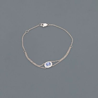 Bracelet formé d'une double chaîne en or...