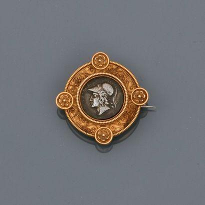 Broche ronde en or jaune , 750 MM, à décor...