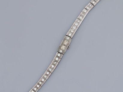 Bracelet montre en or gris 750MM et , platine...