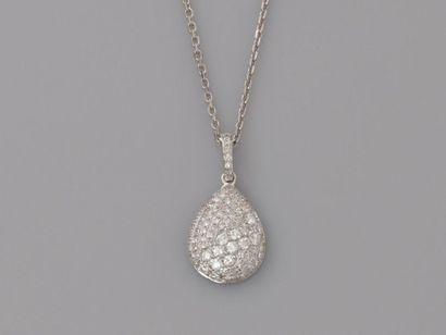 Chaîne ponctuée de diamants et pendentif...