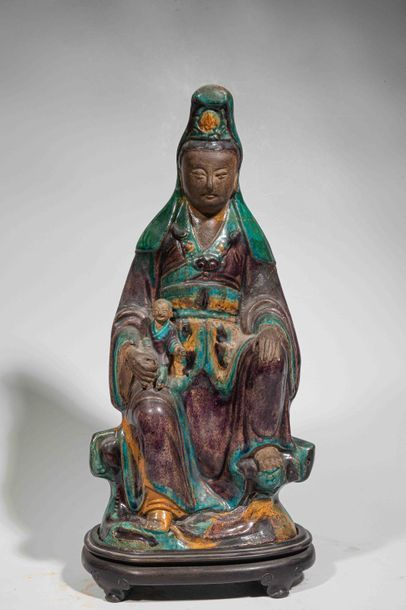Le Boddhisattva Kwan Yin assis en délassement...