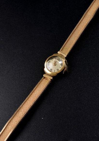 SUIZEX. Montre bracelet de dame en or jaune...