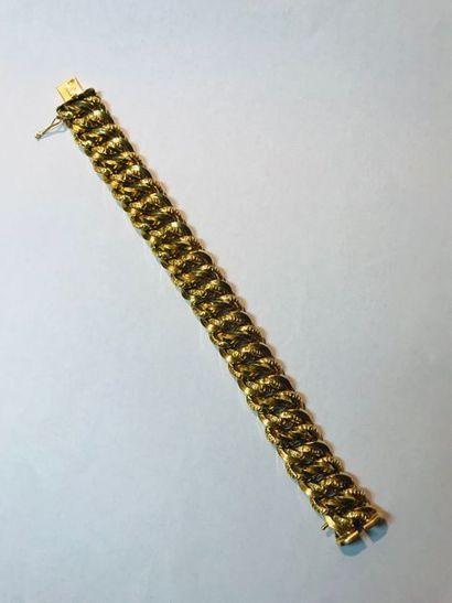 Bracelet gourmette en or jaune 18k, composé...