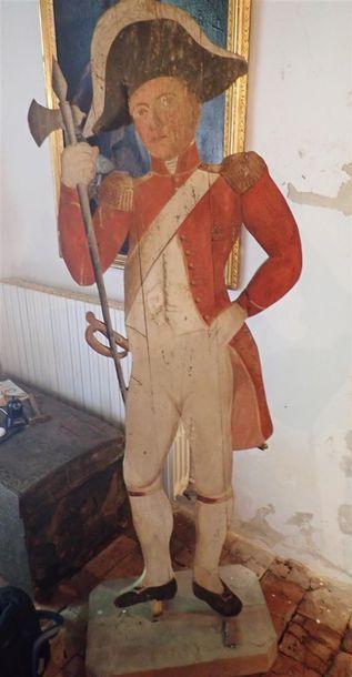 Mannequin de soldat de l'Ancien Régime en bois polychrome. Dimensions: 196x206cm avec le socle