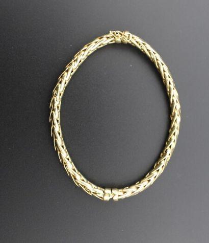 Bracelet jonc en or 750°/°° (18K) semi rigide...