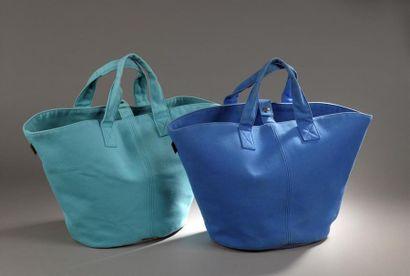 Hermès. Lot de deux sacs seau en toile bleue...