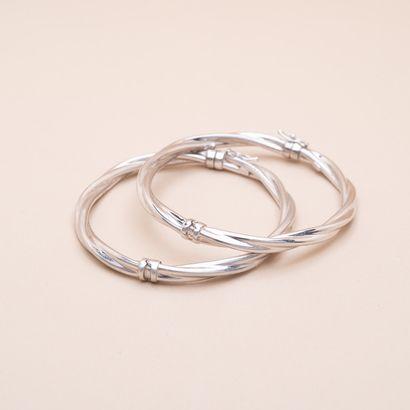 Paire de bracelets jonc torsadés or blanc...