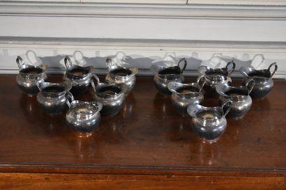 CHRISTOFLE  Suite de douze crémiers en métal...