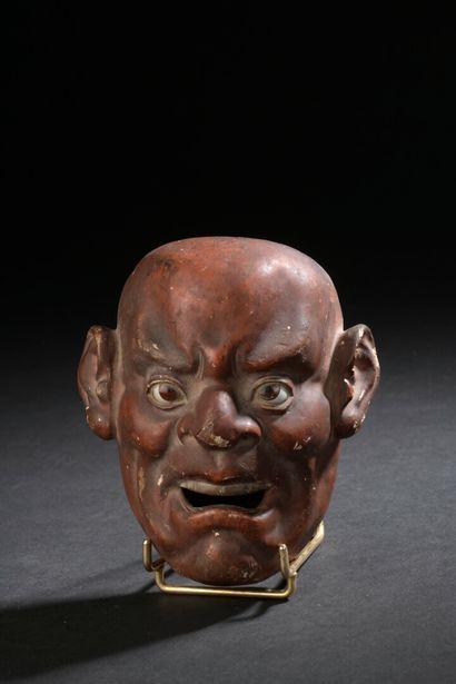 Petit masque Nô en bois laqué brun Japon,...