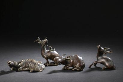 Ensemble de quatre statuettes en bronze  Chine,...