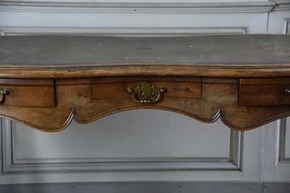 A late 19th century Regency style natural wood moulded flat desk  Opening with three...