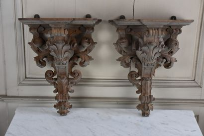 A pair of Louis XV period natural wood bracket brackets  With foliage and scrolls...