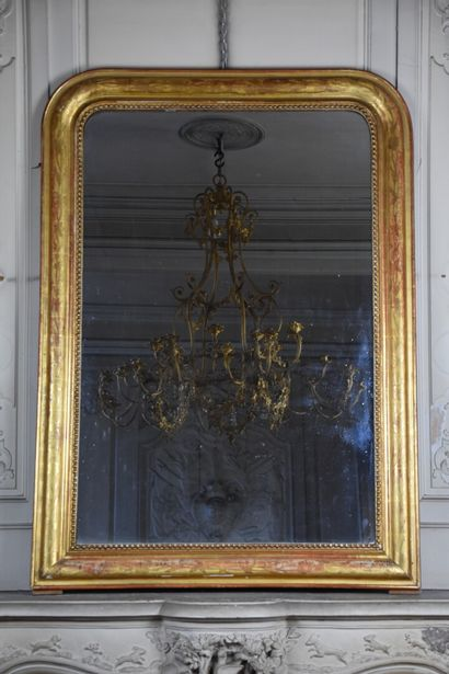 Wood and gilded stucco trumeau, Napoleon III period  Decorated with a frieze of...