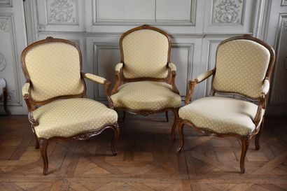 A suite of three Louis XV period moulded and carved natural wood flat-back armchairs...