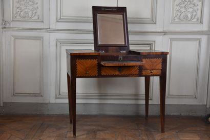 A Louis XVI period rosewood and rosewood veneer dressing table, stamped J.POPSEL...