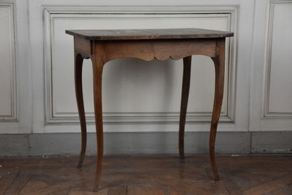 A Louis XV period fir and beech wood writing table  Opening to a drawer, resting...