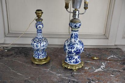Deux vases en faïence montés en lampes  A...