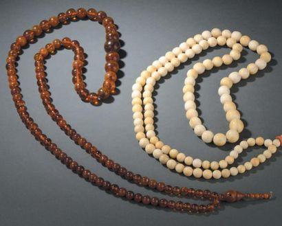 Collier bouddhiste en perles d'ambre et buis...