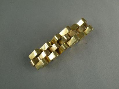 Bracelet tank en or, maille articulée à décor...