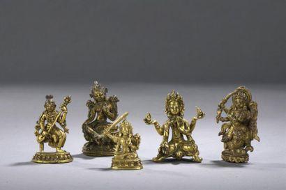 CINQ STATUETTES en bronze doré Tibet, XVIIIe...