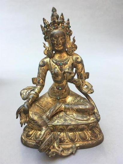 STATUETTE DE TARA VERTE en bronze doré Tibet,...