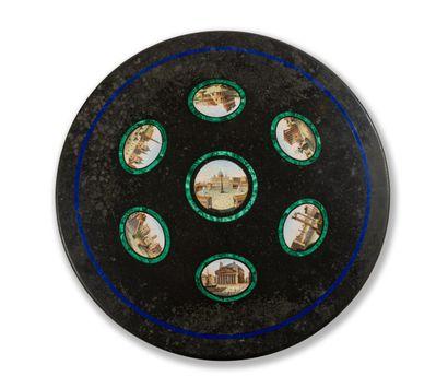 Plateau de marbre noir circulaire présentant sept vues des principaux monuments...