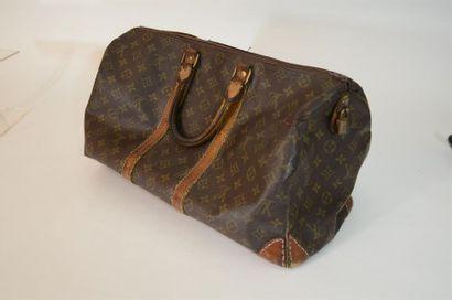 Sac de voyage Louis Vuitton en toile monogrammé...