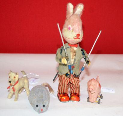 Lot de 4 animaux:  -un lapin jongleur mécanique...