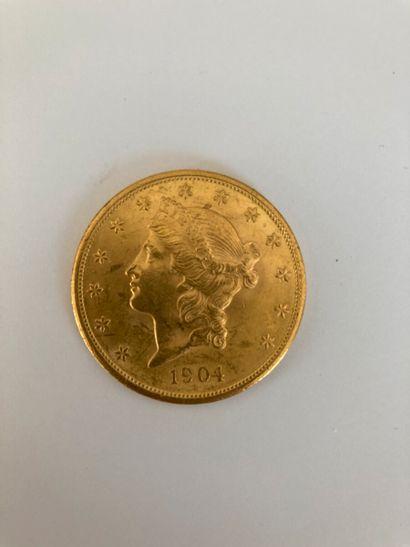 Une pièce de 20 dollars - 1904    Frais acheteurs...