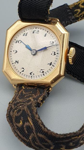 Elegante petite montre de dame en or jaune...