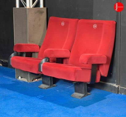 Lot of red cinema armchairs of the brand...