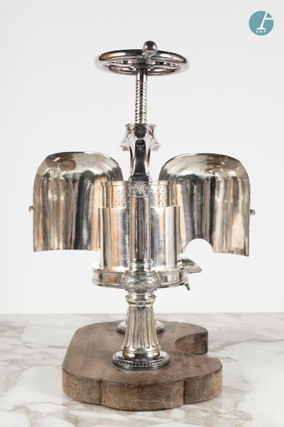 From a prestigious Parisian Palace A silver plated metal duck press, encrypted,...
