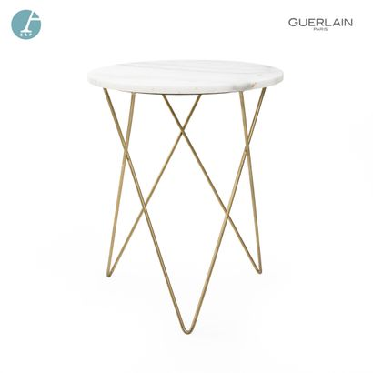 Petite table basse, piètement inox, plateau de marbre veiné gris. H : 60cm -Diamètre...