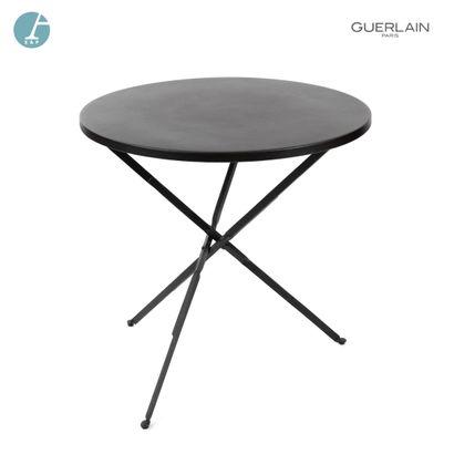 Table circulaire en métal laqué marron.  H...