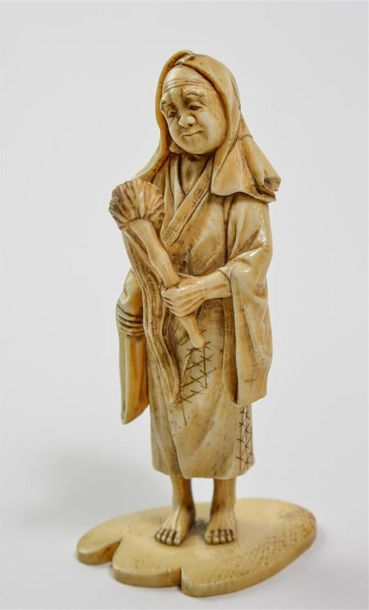 [JAPAN] NAMA HAGE polychrome ivory sculpture of a figure wearing a flycatcher. 19th...