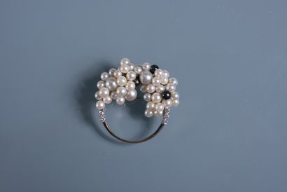 ROUND PINK adorned with white and grey cultured pearls enhanced with small white...