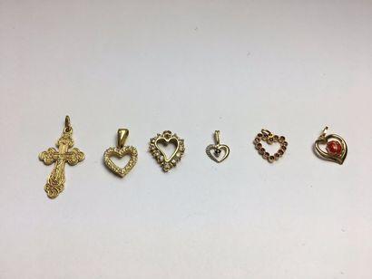 Croix en or jaune 750 guillochée Poids:...