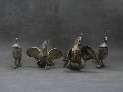 Réunion de quatre oiseaux en métal argenté....
